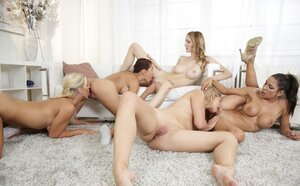Hungry blonde dragged into sex with four lesbians who know how to use strapons