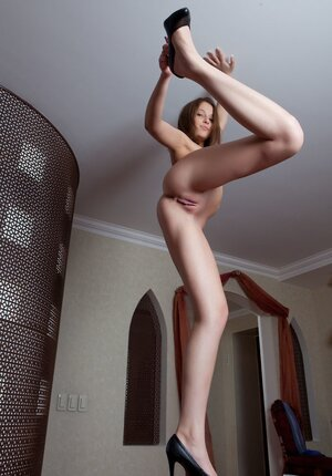 Fine small-tittied Russian young lady Nikia A sheepishly bares her body