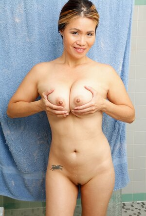 Far eastern female with awesome natural boobs combines taking shower with screenshot session