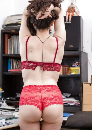 Office worker in red underwear gets on her desk discovering her hot pubic topiary