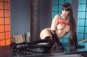 Vitiated pornstar in black leather high boots and gloves flashes her twins