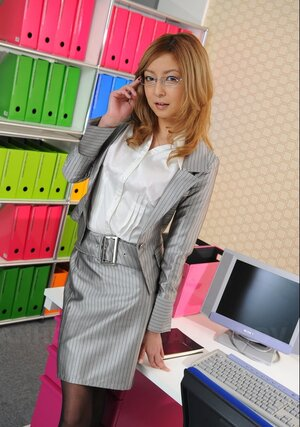Smoking hot Japanese secretary is every single time ready to answer a call and pose being clothed