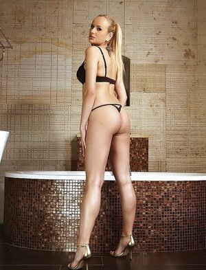 Superb blonde with ponytail impresses boys with awesome assets by bathtub
