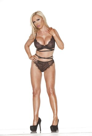 Luxurious blonde cougar seductively poses dressed only in sexy underwear