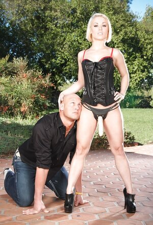 Dominatrix Ash Hollywood dominates over depilated lover by forcing to give head strapon