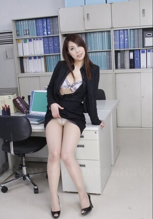 After work cute Japanese secretary undresses in empty office